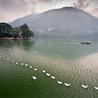 Delhi - Rishikesh - Mussoorie - Auli - Kausani - Binsar - Munsiyari - Patal Bhuwaneshwar - Mukteshwar - Bhimtal - Sattal - Nainital - Corbett