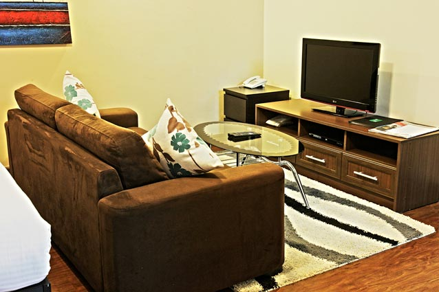 -Airy Lounge with sofa bed and single leather lazy boy couch for added relaxation