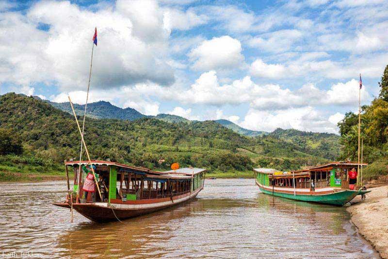 Luang Prabang – Ban Xiengmene – Ban Nong Phou – Tad Houaykua Cycling + Boat Tour