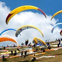 Paragliding, Trekking, Camping Rock climbing, Repelling, River crossing Tour