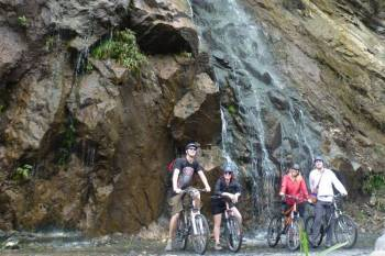 Bike to Kuang Si Waterfall & Cruise the Mekong River Back Fullday